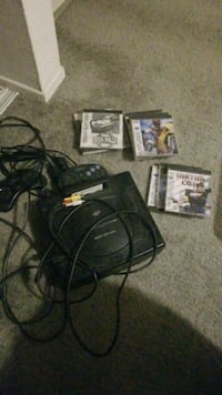 black Sony PS3 slim console with game cases Long Beach, 90808