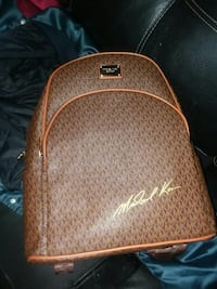 monogrammed brown Michael Kors leather backpack