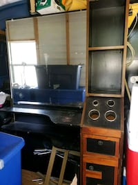 black flat screen TV with brown wooden TV hutch Lynn Haven, 32444