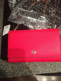 Red Tory Burch leather bag.  Vancouver, V6B 0E7