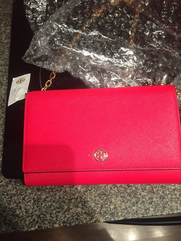 Red Tory Burch leather bag.