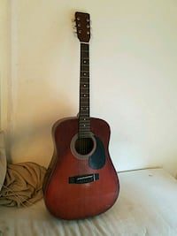 brown and black acoustic guitar Beverly, 01915