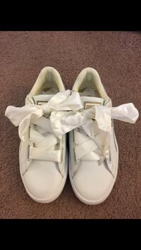 pair of white leather shoes Houston