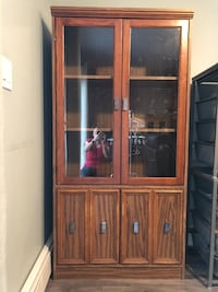 Wood cabinet in good condition. Burnaby