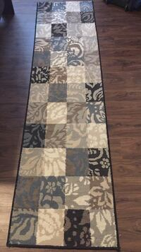 brown, white, and black floral area rug Oak Park, 60302