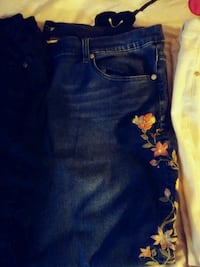 blue denim jeans w/ embroidered flowers