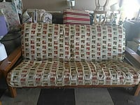 brown wooden-base gray and multicolored padded futon
