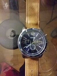 round silver chronograph watch with brown leather strap