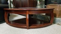 Brown wooden framed glass top coffee table Conyers, 30013