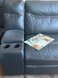 Leather Sectional with two recliners on end . Price is Negotiable .