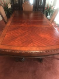 Brown wooden dining table six chairs and China box Houston, 77088