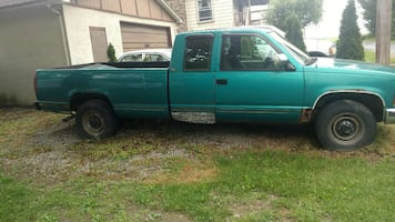 green extended cab pickup truck