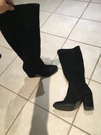 pair of black suede heeled boots