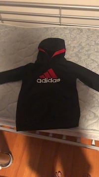 black and red Supreme pullover hoodie 32 km