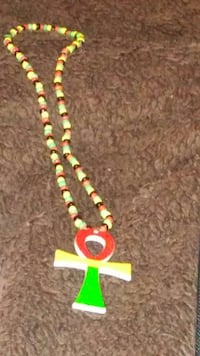 red yellow and green beaded cross pendant Washington, 20009
