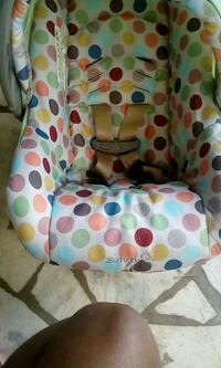 baby's multicolored polka dot Safety bouncer