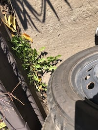 black auto wheel with tire Longueuil, J4T 1T9