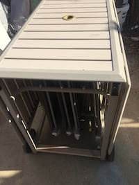 Coleman aluminum folding patio set huge table with 4 chairs. Good condition . Portable, with cover.