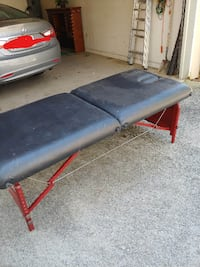 black leather padded massage bed