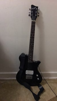 black electric guitar and black guitar amplifier Toronto, M5A