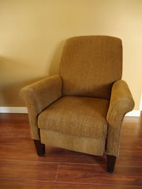 brown fabric sofa chair with throw pillow Calgary, T3C 3R9
