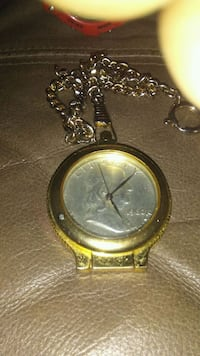 round gold-colored analog watch with link bracelet Kings Mountain