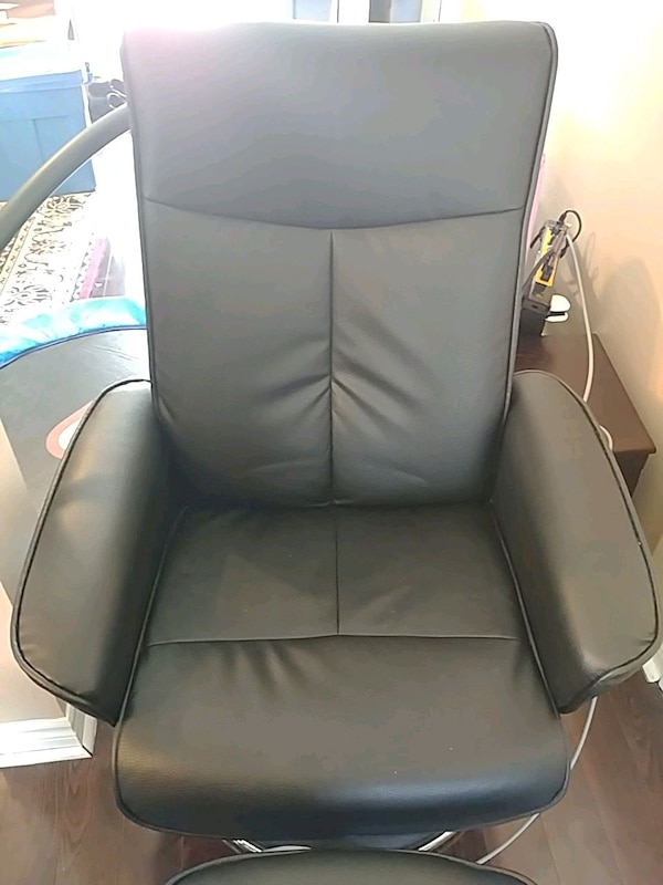 Black swivel manual recliner with ottoman