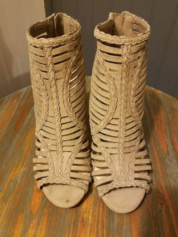pair of brown gladiator shoes