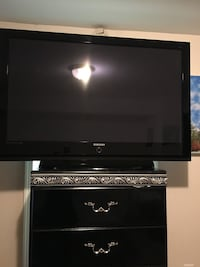black flat screen TV with remote Sterling, 20165