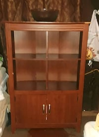 brown wooden framed glass cabinet Yucca Valley, 92284