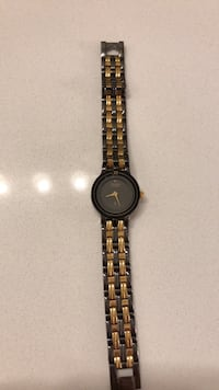 Black and gold citizen watch  Cambridge, N1P 0A2