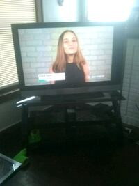 60 inch Vizio TV and black Glass TV stand that holds up to 100in tv