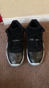 pair of black Air Jordan 11's