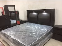 black wooden bed frame with white mattress 1490 mi