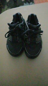 toddler's black-and-gray low-top sneakers