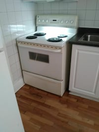 white and black electric coil range oven