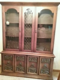 brown wooden framed glass display cabinet Iowa City, 52245