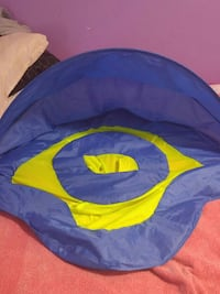 baby's blue and yellow umbrella floater Quebec, H8N 1C2