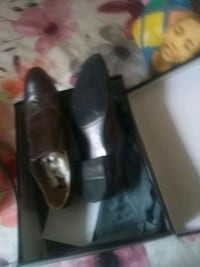 pair of black leather shoes Bronx, 10454