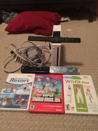 Wii console with 2 remotes and 3 games and all the cords needed