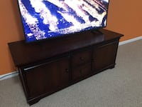 black flat screen TV with black wooden TV stand Germantown, 20876