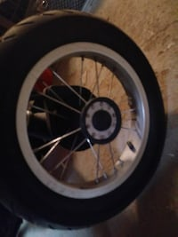gray motorcycle wheel with tire