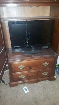 Armoire with 2 drawers. Missing one handle Henderson, 89011