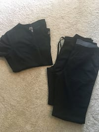 Black Sanibel Scrubs. Size small. Two tops. Two bottoms Norristown, 19403