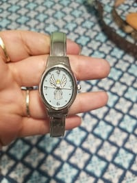 oval white angel face analog watch with silver-col