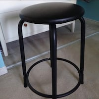 round black metal framed leather padded seat