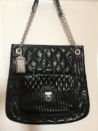 quilted black Coach leather sling bag