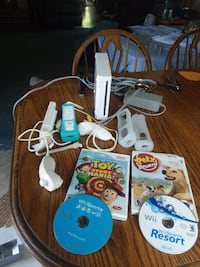 white Nintendo Wii console with controller and game cases HALETHORPE