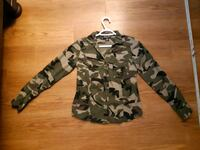 black and gray camouflage zip-up hoodie Calgary, T2V 0M2
