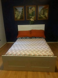 brown wooden bed frame with white mattress Burke